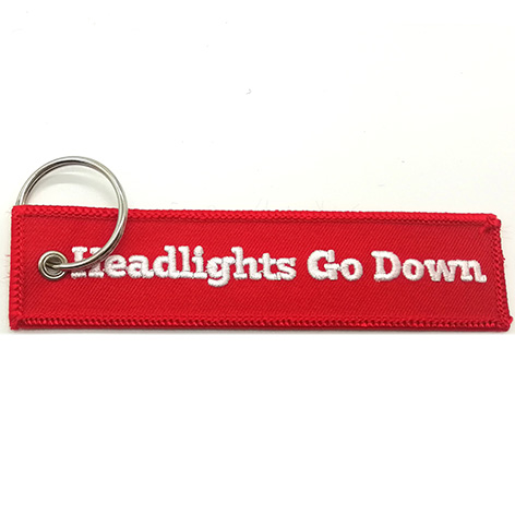 embroidered kiss me before flight keychain Go down Featured Image